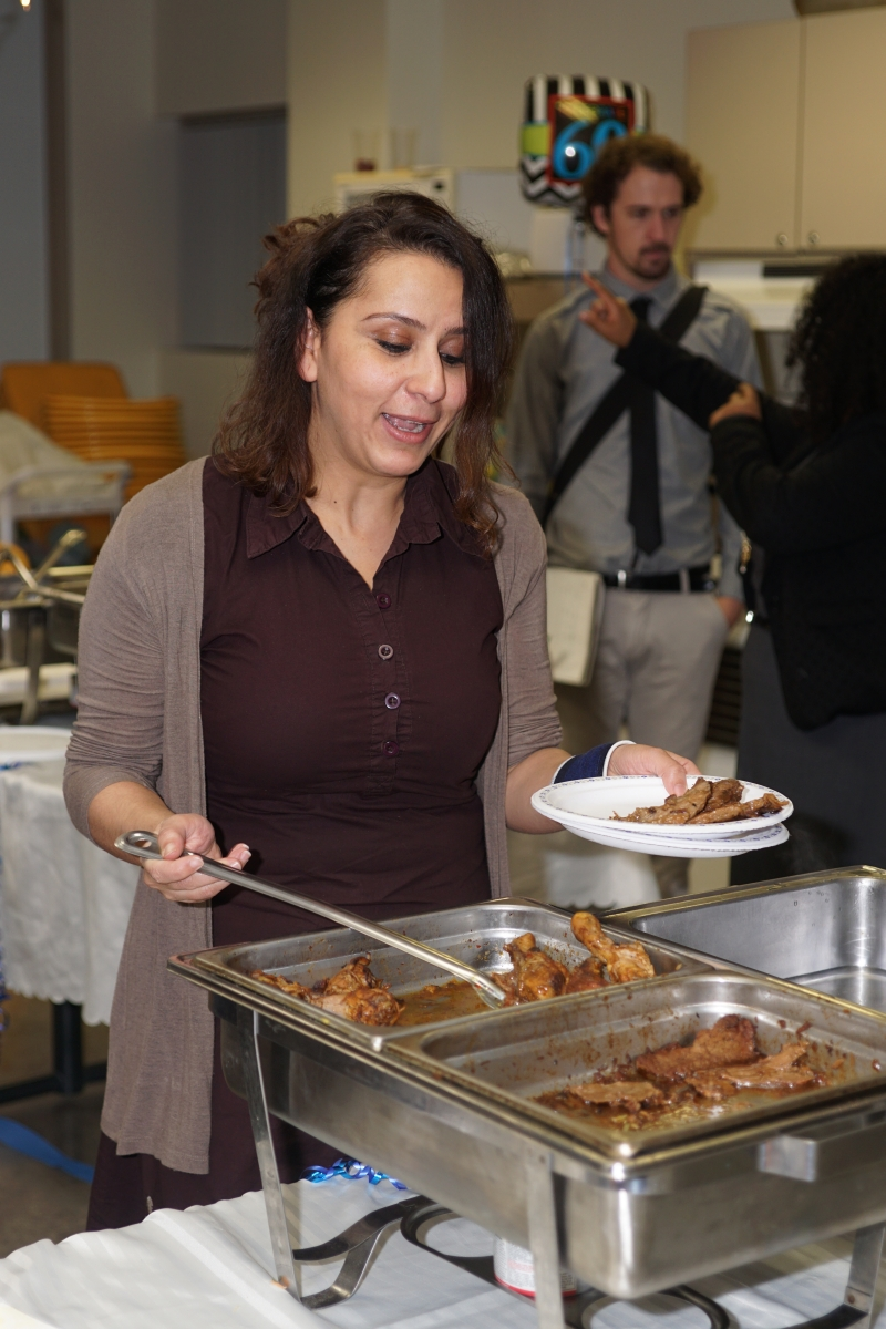 Woman serving food at 60th anniversary celebration