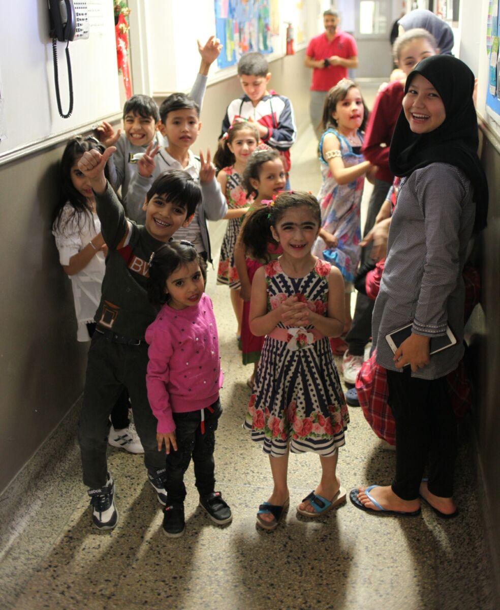 Children stand in a hallway