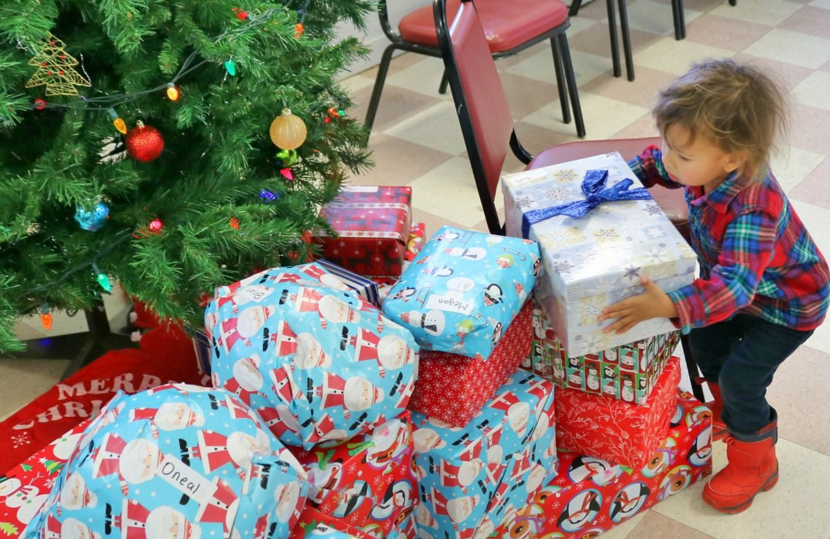 Child opening Christmas gift
