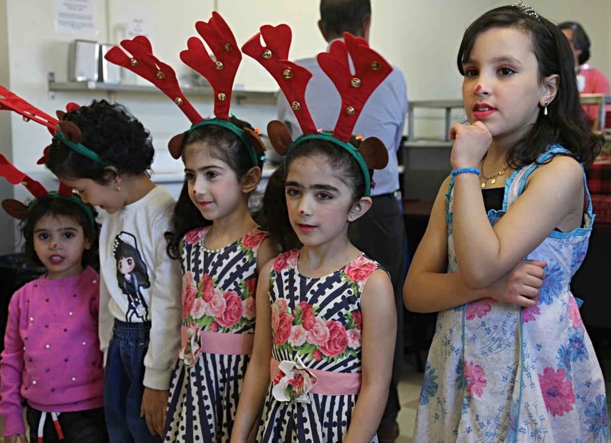 Children get ready to sing