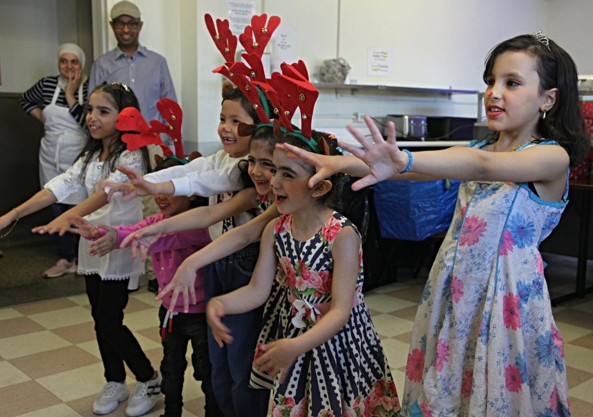 Children perform Christmas song