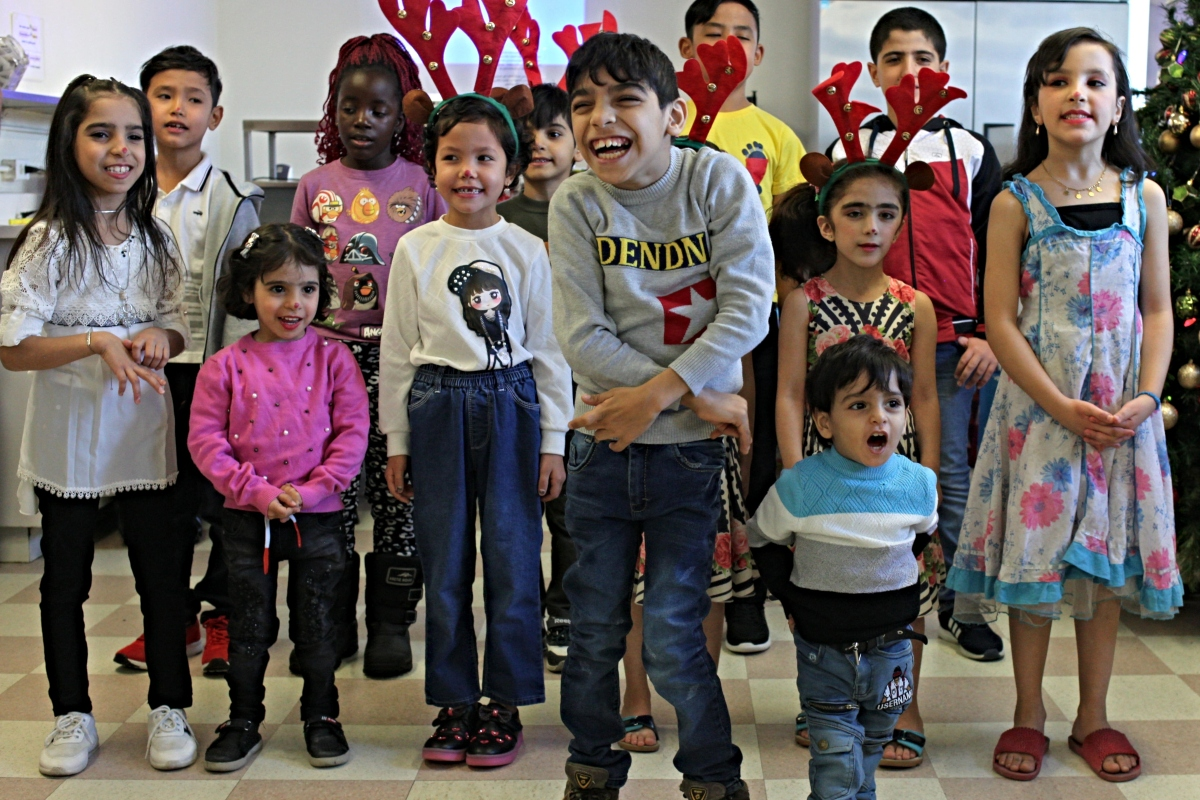 Smiling children getting ready to sing