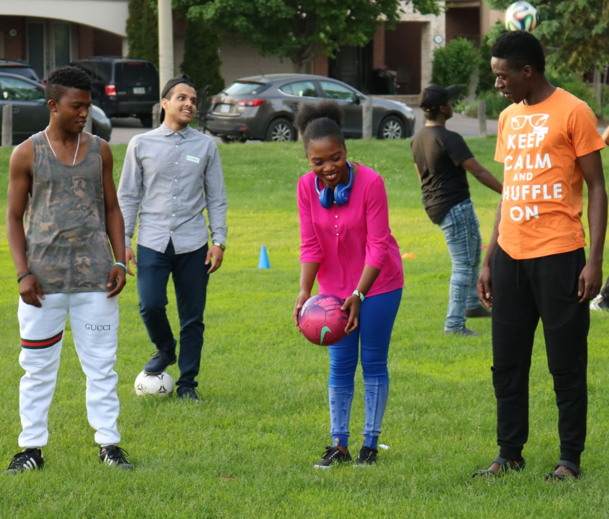 Young people kick around a soccer ball