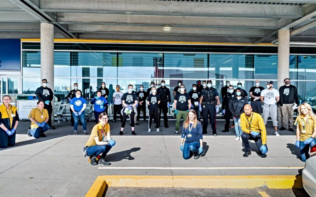 Group of people poses outside IKEA store