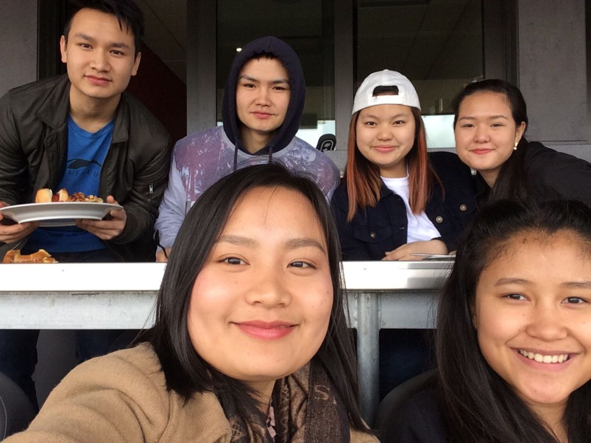 A group of youth newcomers pose for a selfie at an Ottawa Fury game.