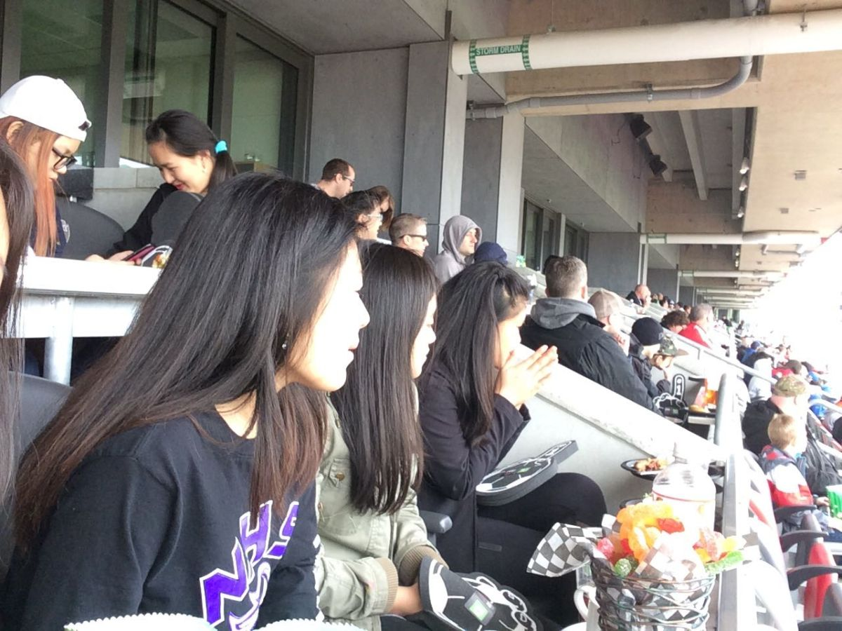 A group of youth newcomers watch an Ottawa Fury game.