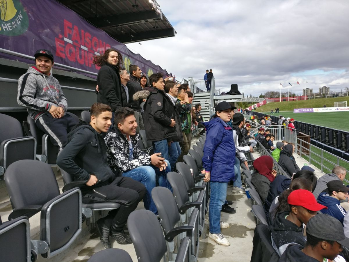 A group of youth newcomers attend an Ottawa Fury match