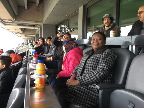 A group of newcomers, staff and volunteers attend an Ottawa Fury match