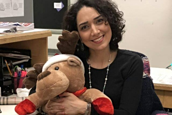 Smiling woman holding stuffed moose