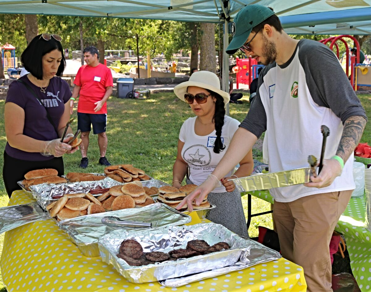 Three people serve food