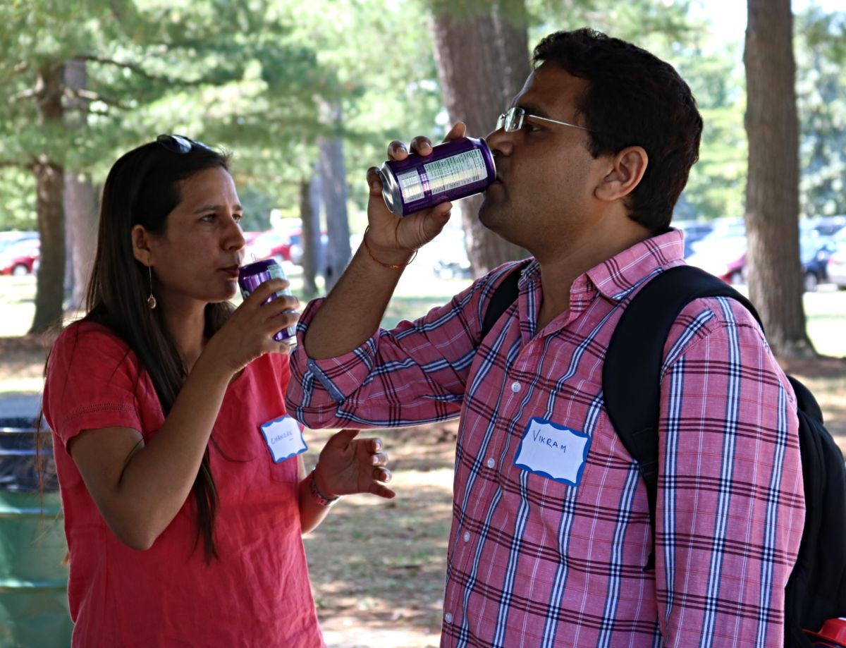 Man and woman enjoy a soda pop