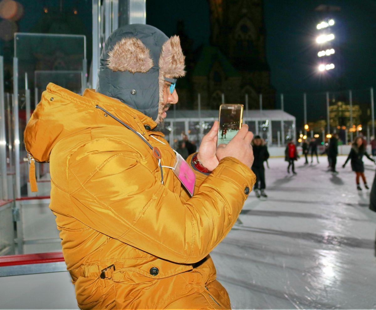 Man taking photos at skating rink