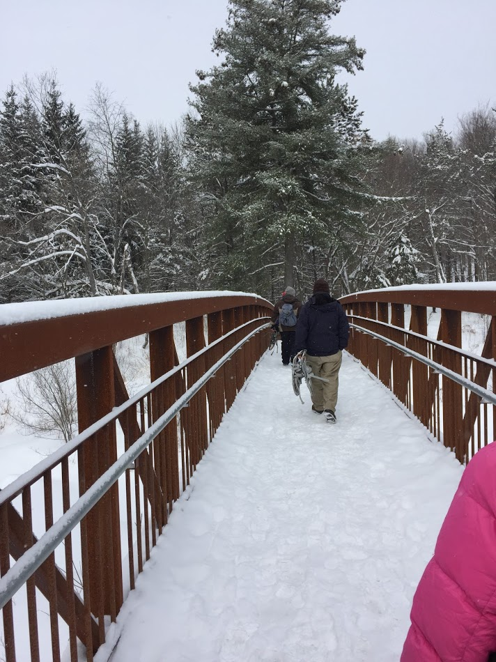 People get ready to snowshoe