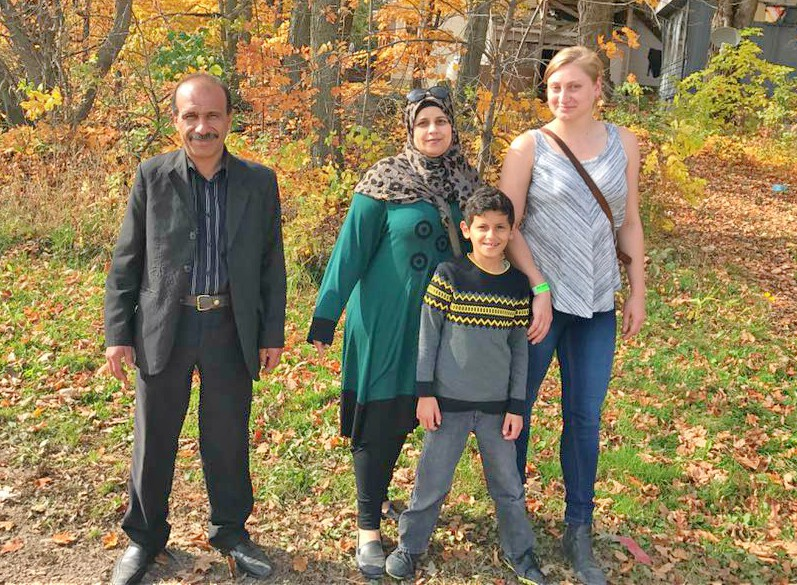 Family poses for photo at farm visit