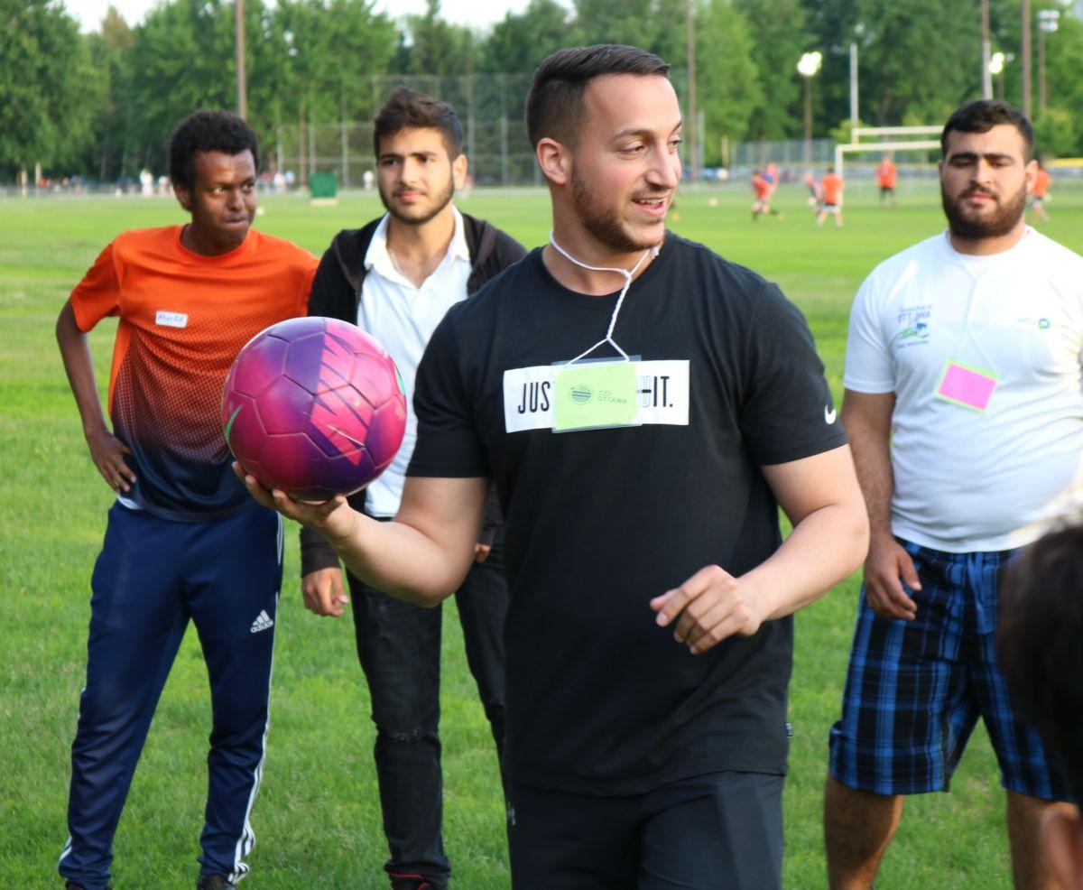 Young men handling a soccer ball