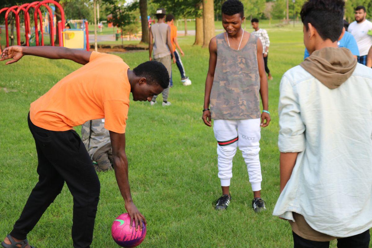 Teens play soccer