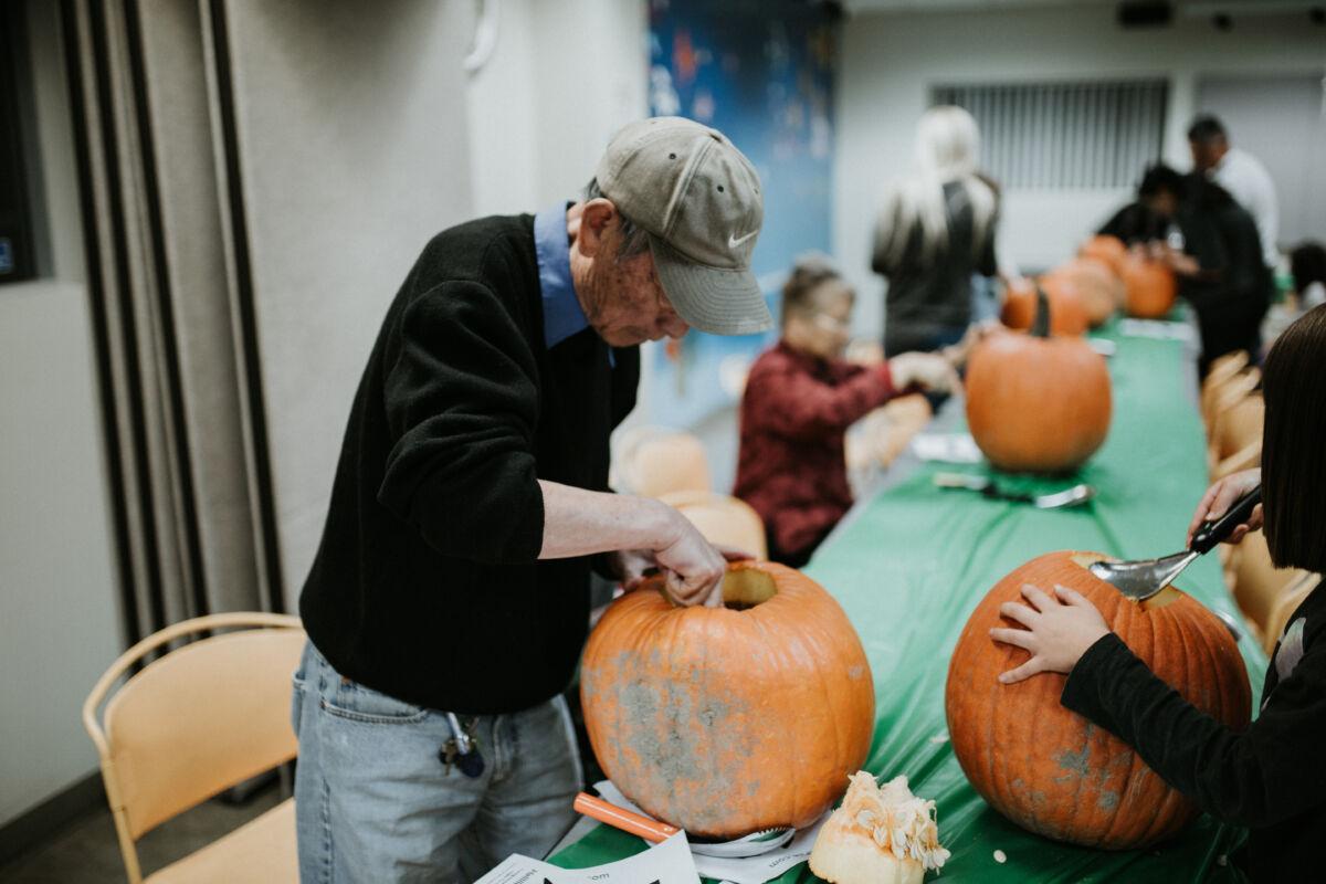 Man scoops out pumpkin