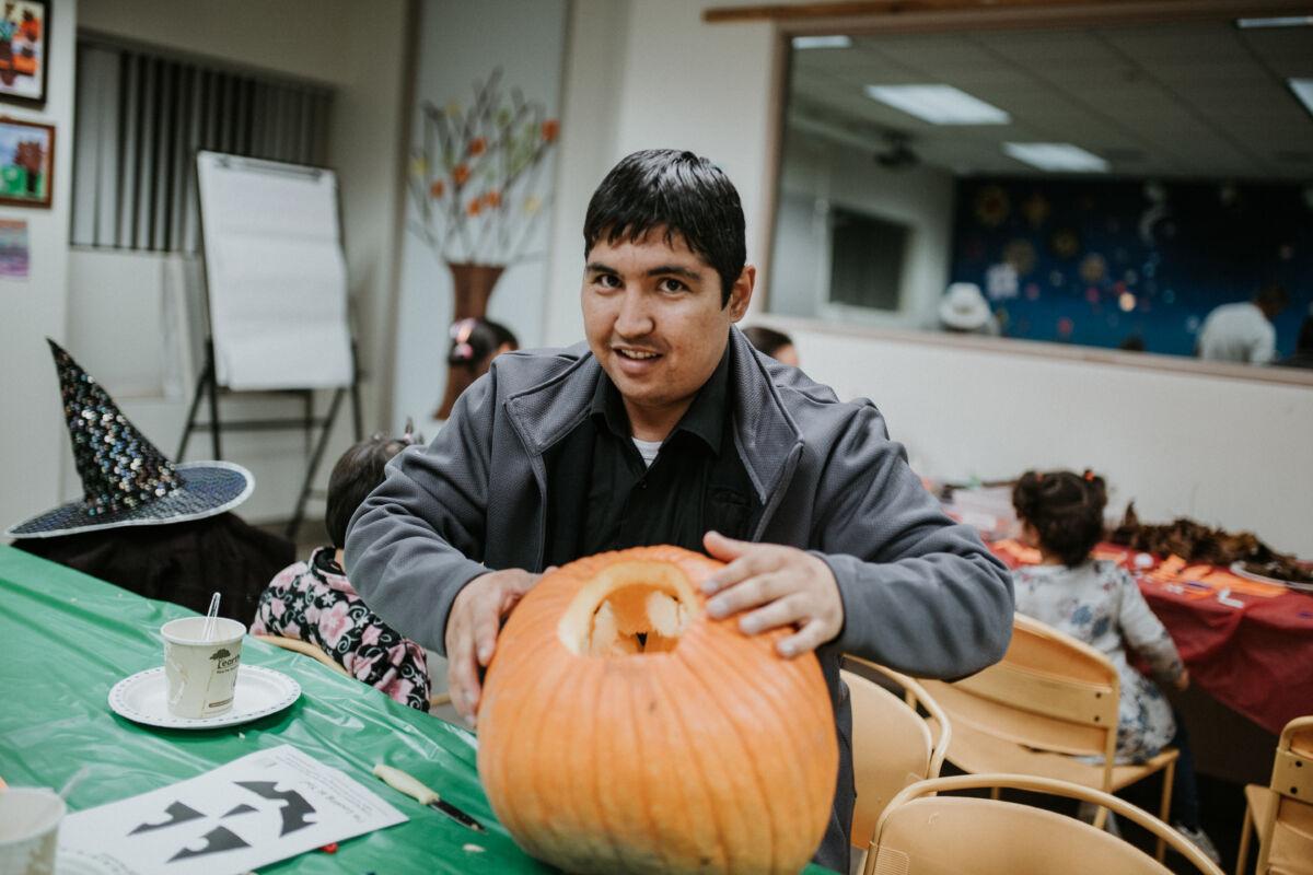 Man shows off carved pumpkin