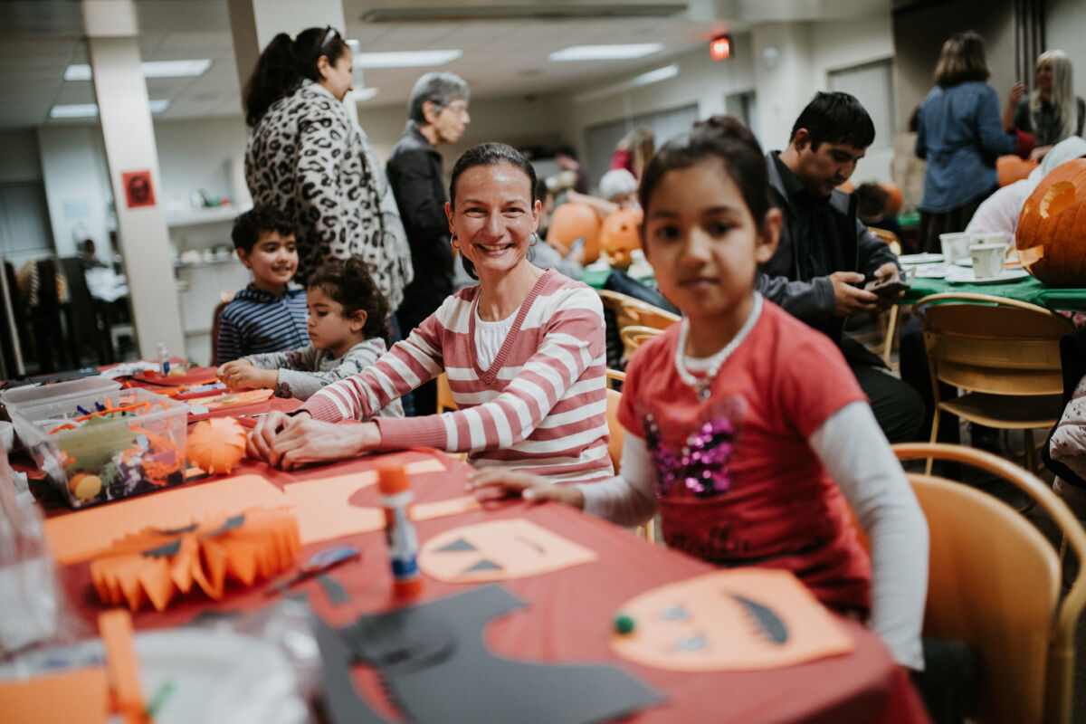 Woman and young girl create pumpkin crafts