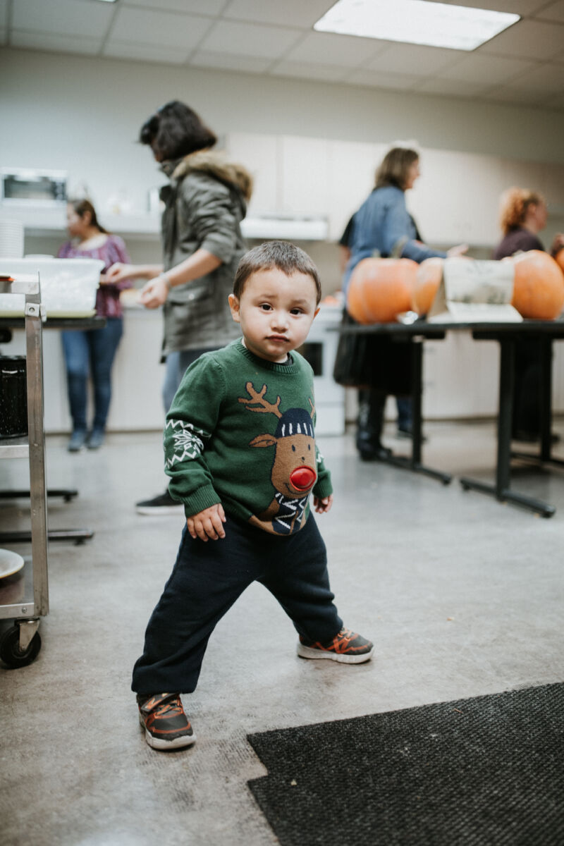 Young boy wearing a Christmas sweater