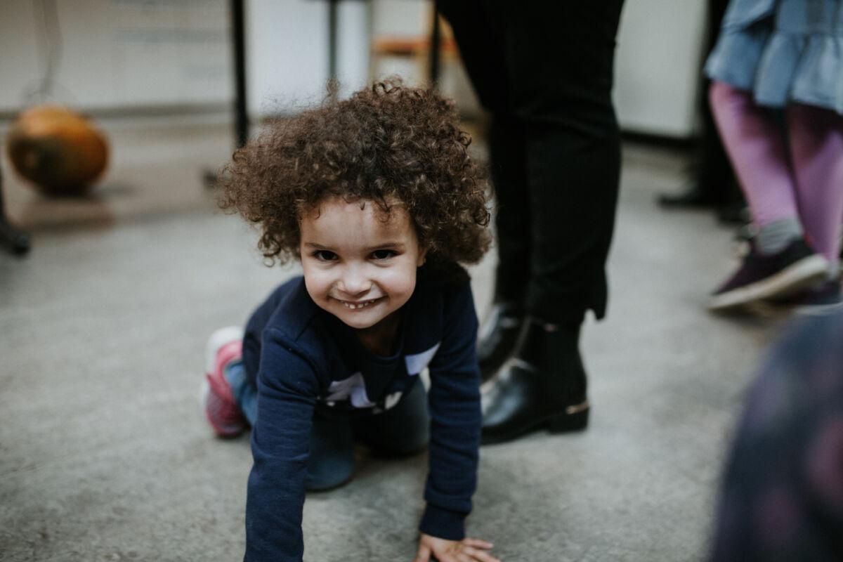 Child crawls on the floor