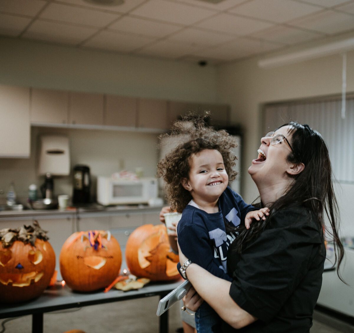 Woman laughs with child