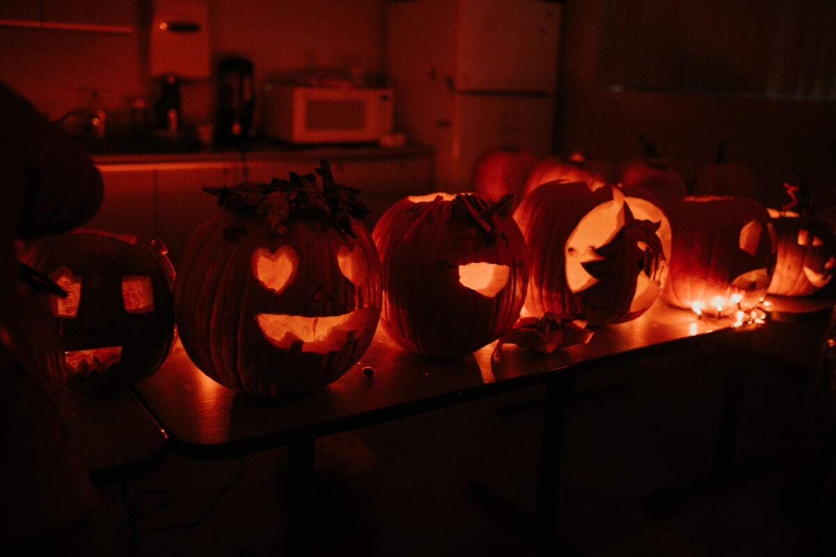 Pumpkins lit up with candles